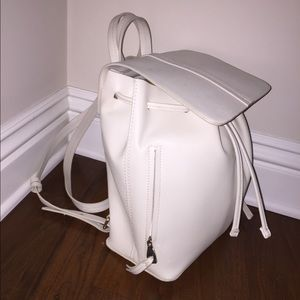 White leather backpack with drawstring
